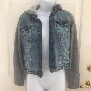 jean/denim jacket has gray  sleeves and a hood